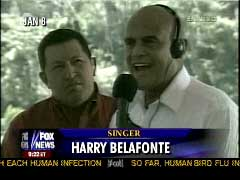 Belafonte demonstrating his hatred of his country's President with his new communist ally Hugo Chavez