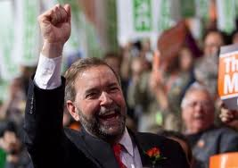 NDP leader Mulcair with clenched fist.